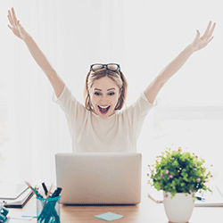 Happy Girl working on laptop
