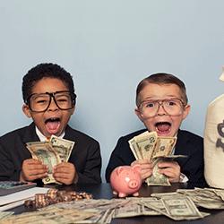 Happy kids counting money
