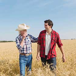 Two males in a hay field Commercial Loans